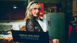 Kiernan Shipka, in a Riverdale-branded seat, will appear as Sabrina Spellman in Riverdale season 6