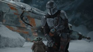 Pedro Pascal and Grogu in The Mandalorian on Disney+.