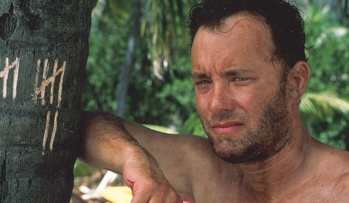 Cast Away Tom Hanks looking away from tally marks on a tree
