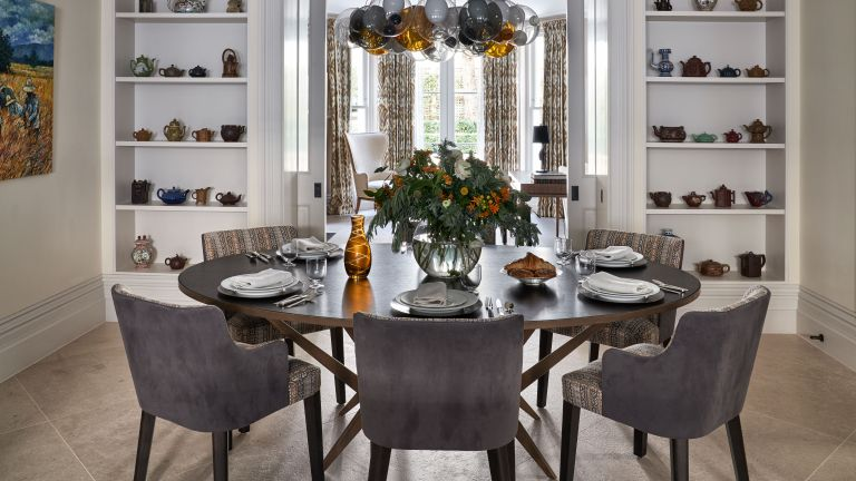 Dining room ideas with shelving and velvet grey chairs