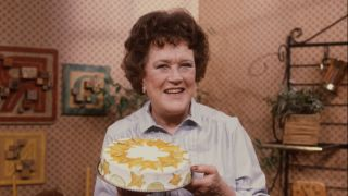 Julia Child holds a cake