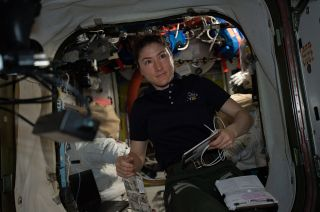 NASA astronaut Christina Koch, as seen on board the International Space Station on April 8, 2019, will set a new record for the longest single space mission by a woman at 328 days.
