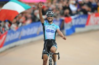 Tom Boonen raises four fingers in the arm as he wins the 2012 edition