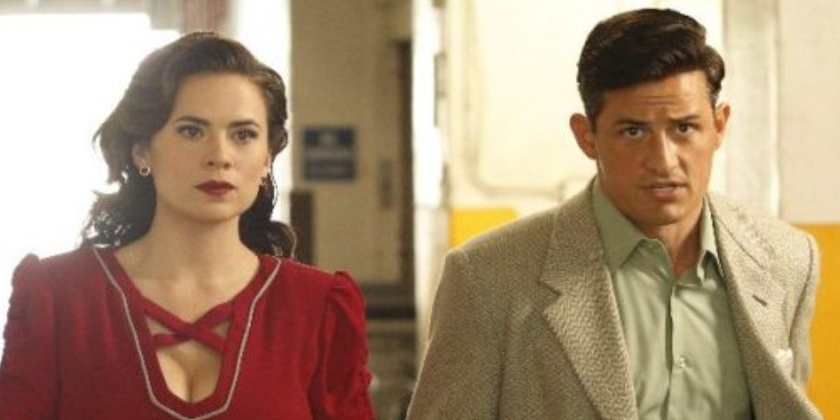 Hayley Atwell as Peggy Carter and Enver Gjokaj as Daniel Sousa on Agent Carter (2016)