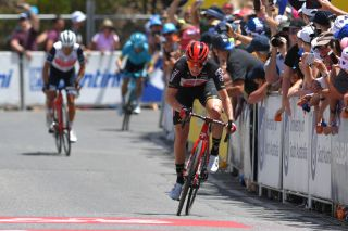 Lotto Soudal's Matt Holmes powers to victory on stage 6 of the 2020 Tour Down Under, leaving the hitherto king of Willunga Hill, Richie Porte, in his wake