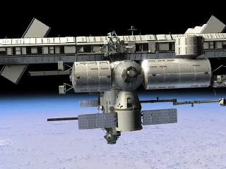 SpaceX Dragon cargo ship docked with the International Space Station in this artist's illustration.