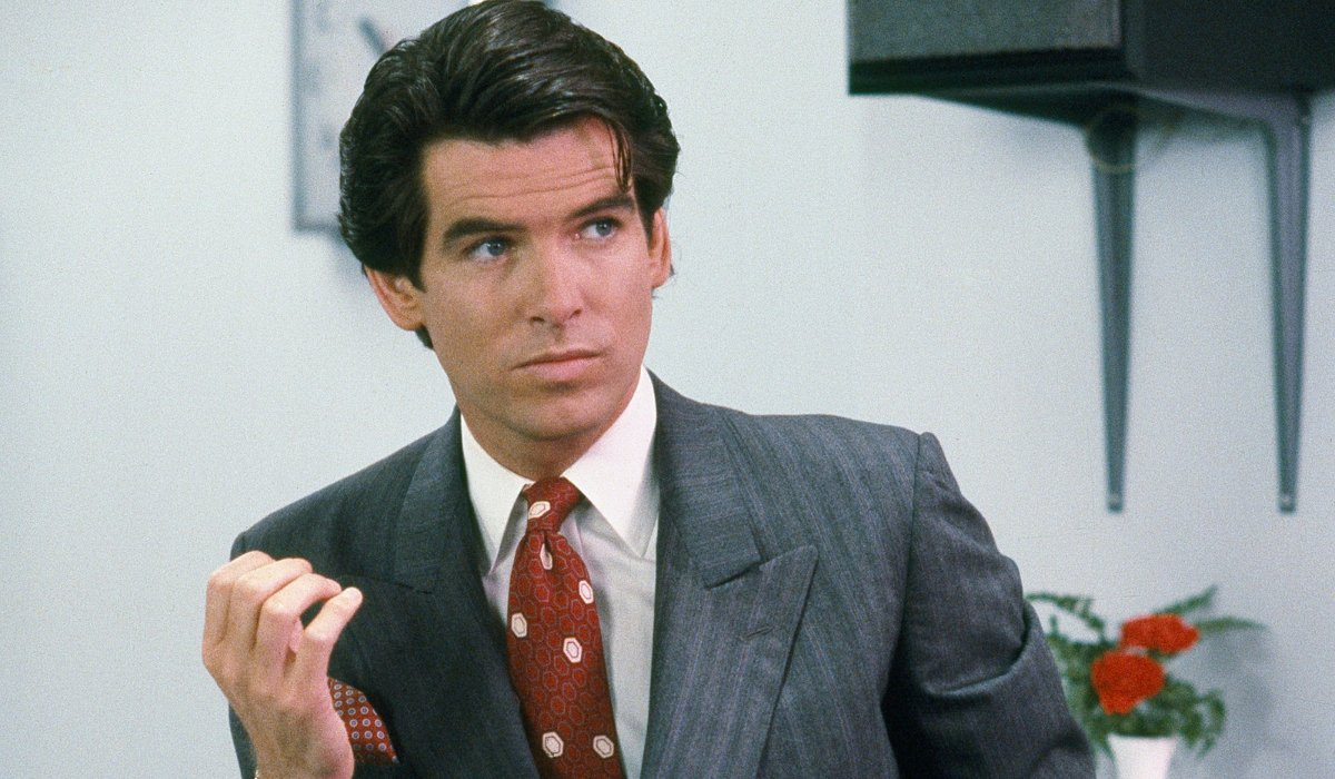 Remington Steele Pierce Brosnan poses in a power suit