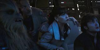 Solo: A Star Wars Story Woody Harrelson Emilia Clarke Alden Ehrenreich looking up at danger