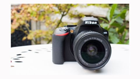 Image shows a front view of the Nikon D3500.