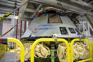 The Boeing CST-100 Starliner spacecraft is pictured at the company's Commercial Crew and Cargo Processing Facility in Florida, undergoing inspection after its Orbital Flight Test.