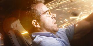 Ryan Reynolds as Guy driving a car in Free Guy