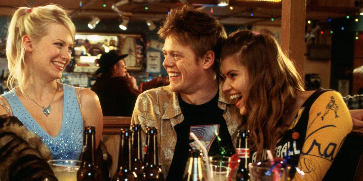 January Jones, Kris Marshall, and Ivana Miličević in Love Actually