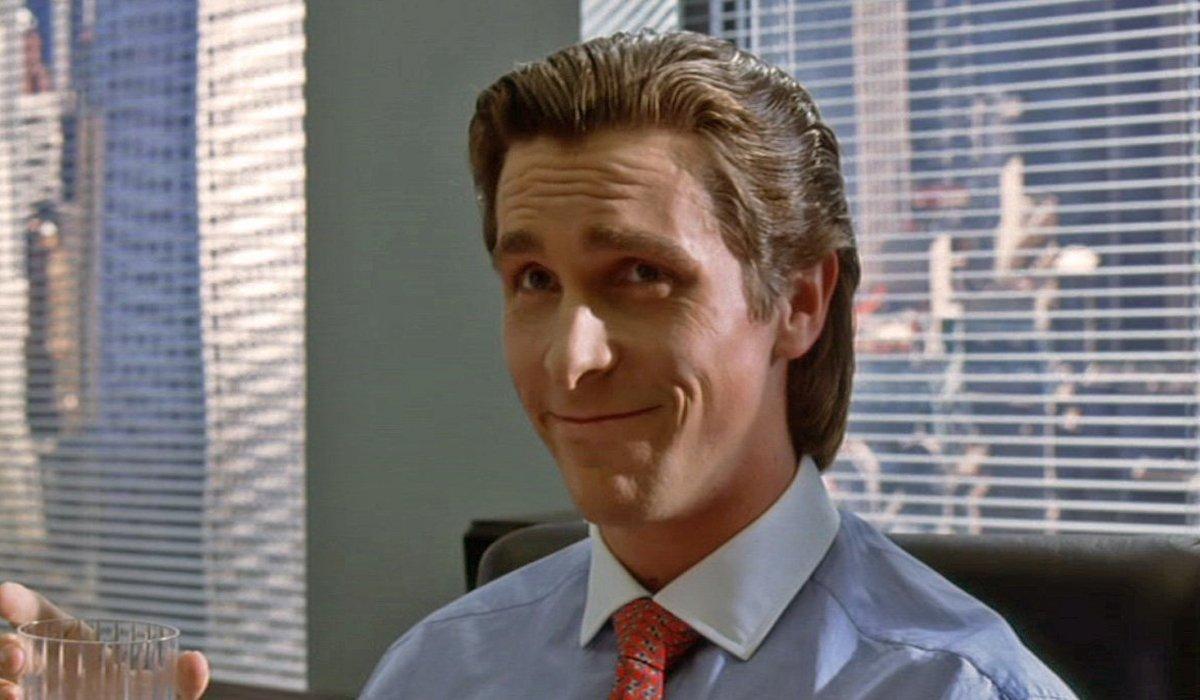 Christian Bale smiles as Patrick Bateman in American Psycho