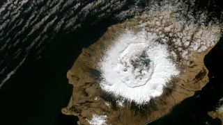 Alaska's Umnak Island in the Aleutians on May 3, 2014, showing the 6-mile (10-kilometer) wide caldera largely created by the Okmok II eruption in 43 B.C.