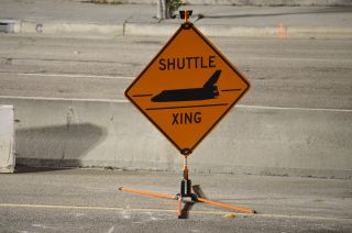 Traffic Management Inc.'s 'Shuttle Xing' road sign as seen at Los Angeles International Airport, Oct. 12, 2012.