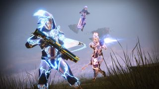 Three Destiny guardians in glowing armour