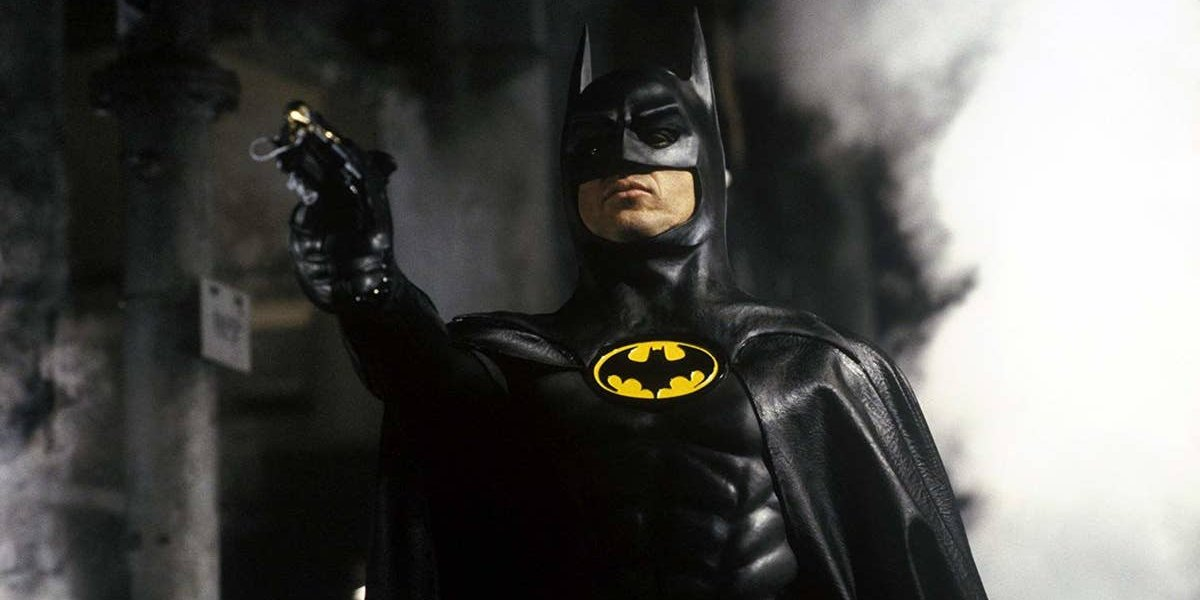 Batman Michael Keaton prepares to fire a grappling hook