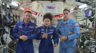 From left to right, NASA astronauts Andrew Morgan, Jessica Meir and Chris Cassidy answer questions from the media on April 10.