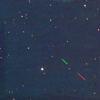 Asteroid 2011 MD seen in red, green, and blue from Faulkes Telescope South