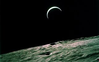 Earth's Crest Over the Lunar Horizon
