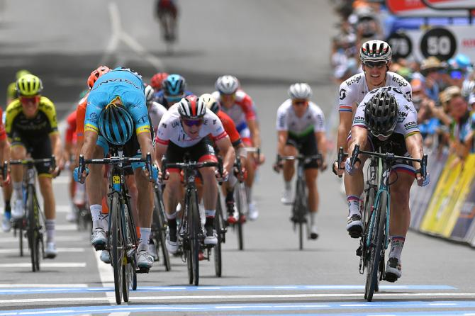 Luis Leon Sanchez and Peter Sagan throw their bikes for the line during stage 3 at the Tour Down under. Sagan got the win.