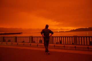 A man watches California wildfire smoke blot the sky in September 2020.