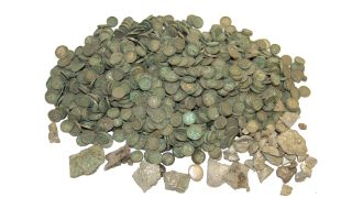 The medieval hoard contained thousands of silver coins and ingots.
