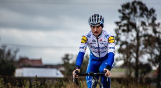Yves Lampaert shows off Deceuninck-QuickStep's one-off Elegant-QuickStep jersey that will be used at the 2020 Tour of Flanders