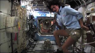 NASA astronaut Sunita Williams Demonstrates Bike Workout on the International Space Station