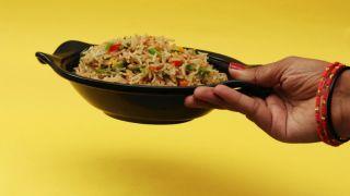 Lady holding rice