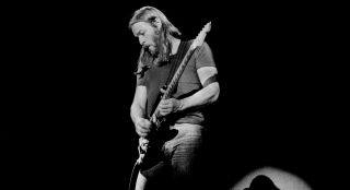 David Gilmour performs live with Pink Floyd onstage at Ahoy in Rotterdam, Holland in February 1977