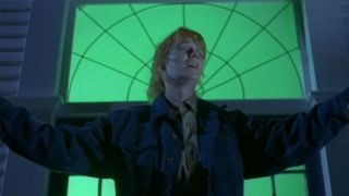 Marg Helgenberger as Bobbi Anderson raises her arms in The Tommyknockers