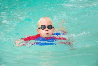 Boy in swimming pool.