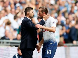 Tottenham's Harry Kane with Mauricio Pochettino during the Premier League match at Wembley Stadium, London. Picture date 18th August 2018.