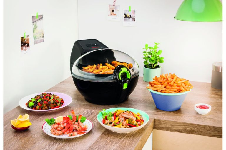 Best air fryer: setup in kitchen with food surrounding