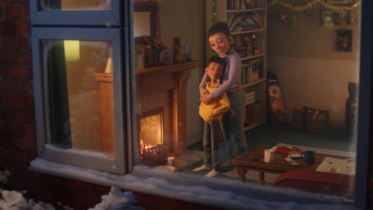McDonald's UK Christmas Advert 2020, boy and his mother embracing in cosy living-room