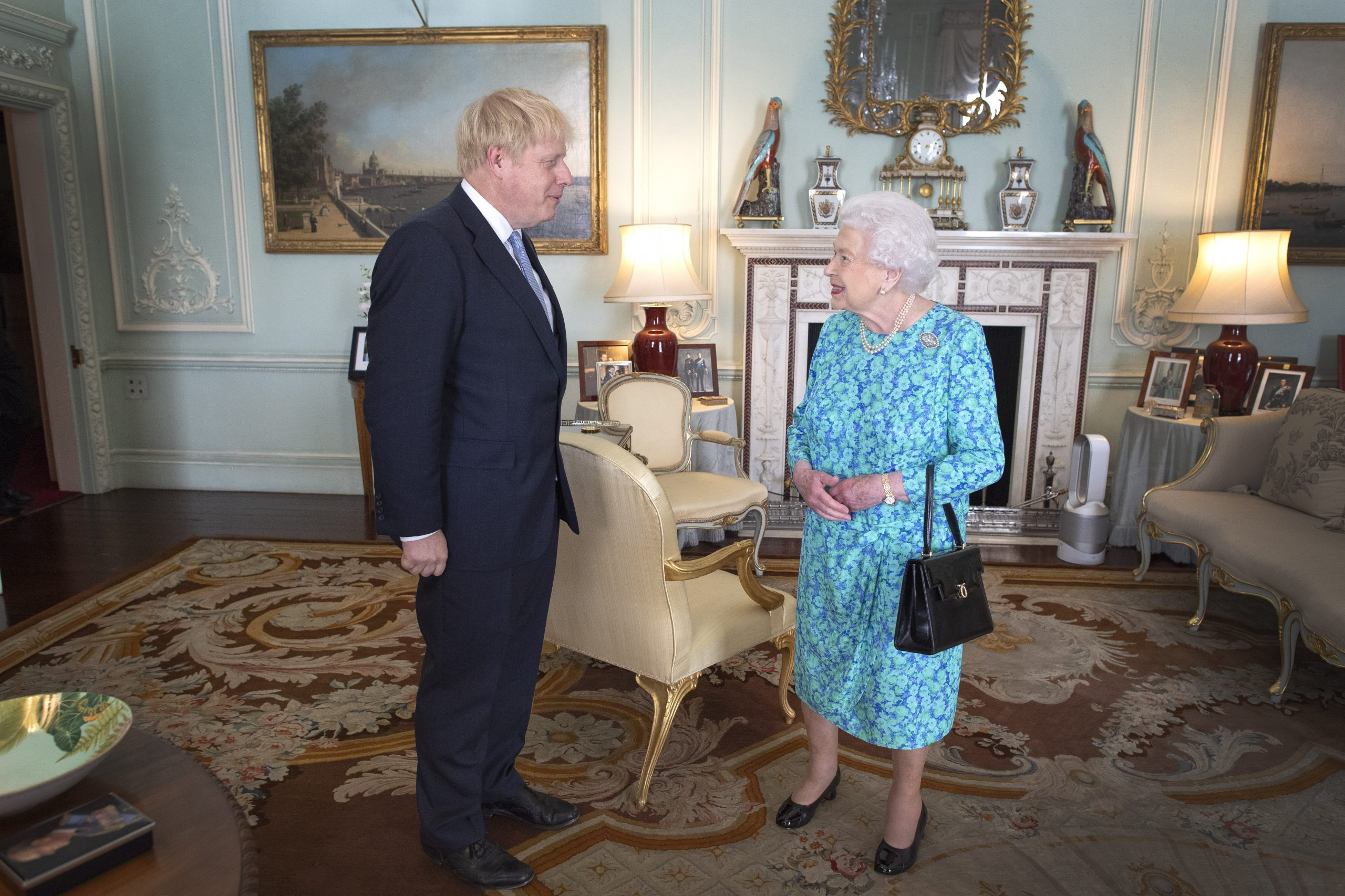 Meghan and Harry photo behind the Queen and Boris Johnson