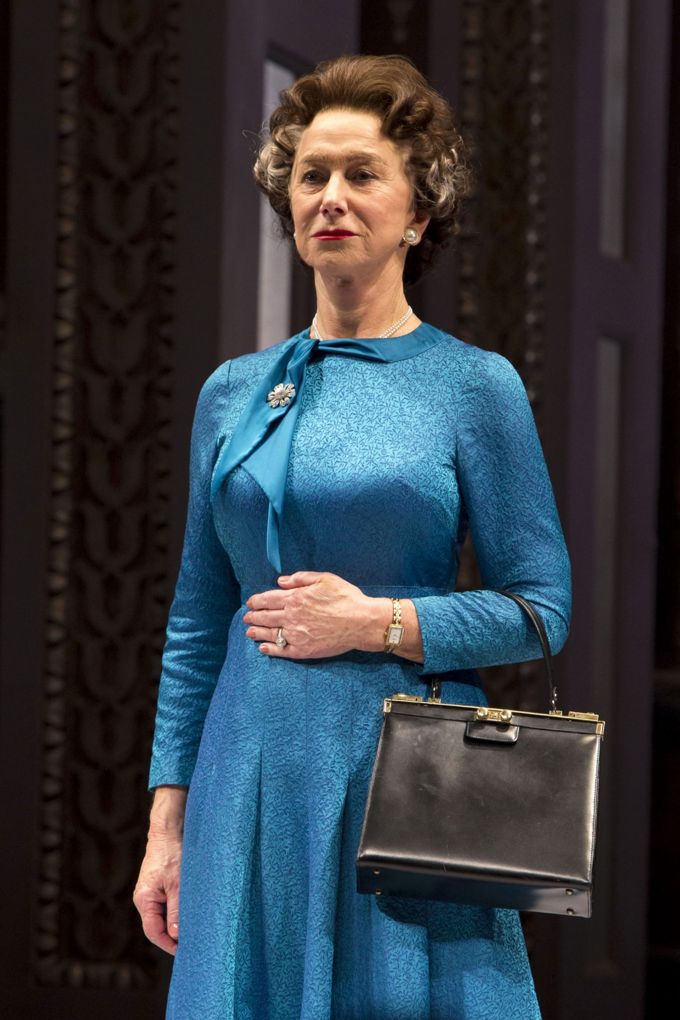 Helen Mirren appears on stage as The Queen at the Broadway opening night curtain call of The Audience in 2015