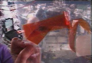 NASA Eyes Worrisome Debris in Space Station Joint
