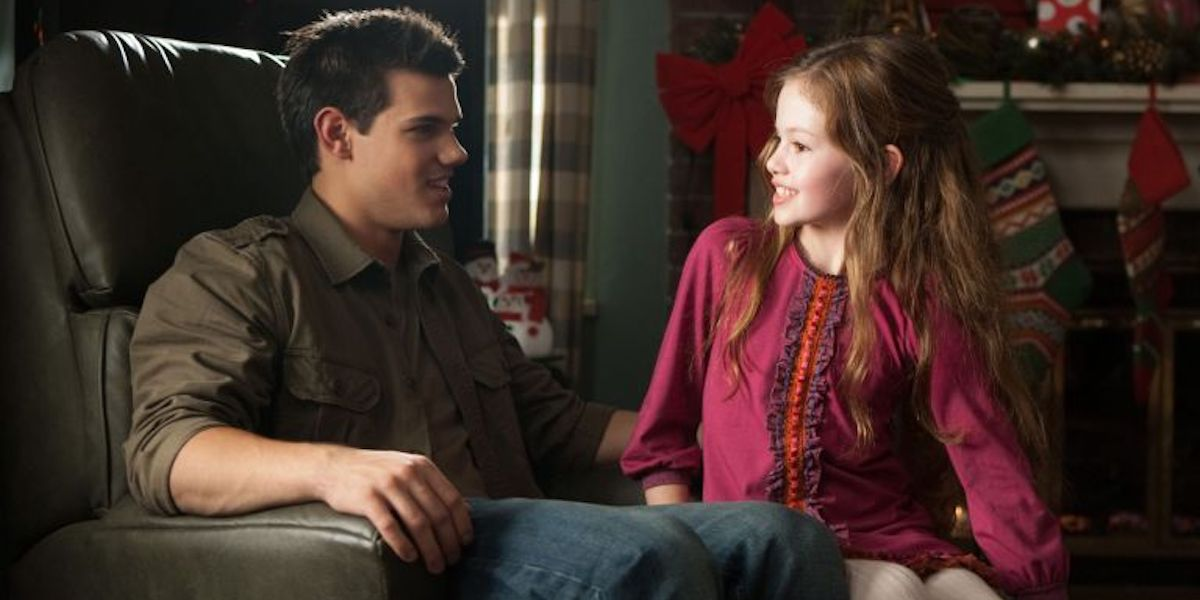 Jacob Black and young Renesmee in Twilight Saga: Breaking Dawn
