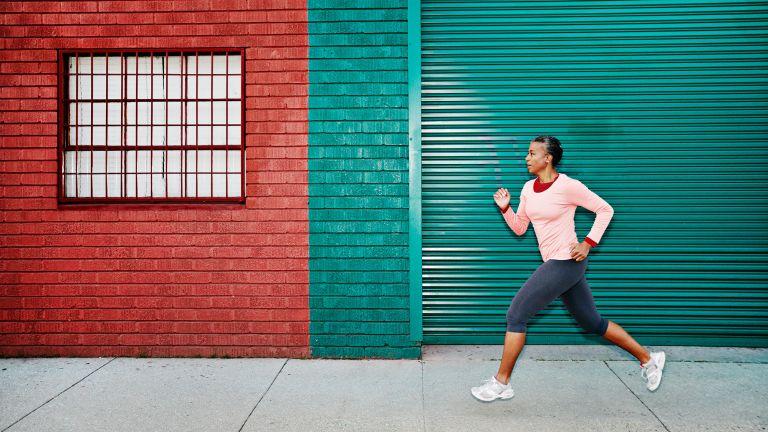 Woman on an urban run, as part of a running plan for beginners