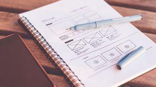 Notebook with UI ideas written in it