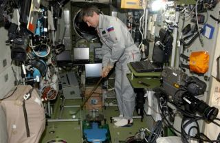 Next ISS Commander's Spacewalk Golf Shot Raises Concerns