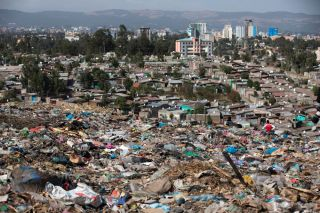 A photo taken on March 12, 2017, shows a view of Addis Ababa from the main landfill on the outskirts of the city, a day after a landslide at the dump left more than 100 people dead.