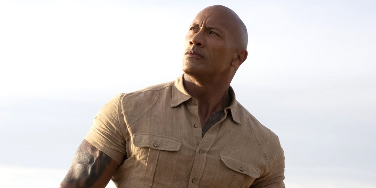 Dwayne Johnson looks into the distance Jumanji: The Next Level