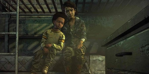 Clementine and her friend from The Walking Dead sit on a bunk, sad.
