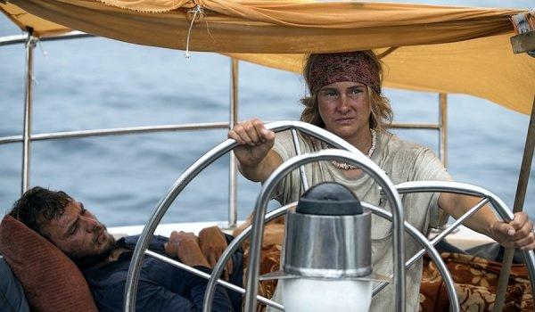 Adrift Sam Claflin Shailene Woodley sitting at the wheel of the ship