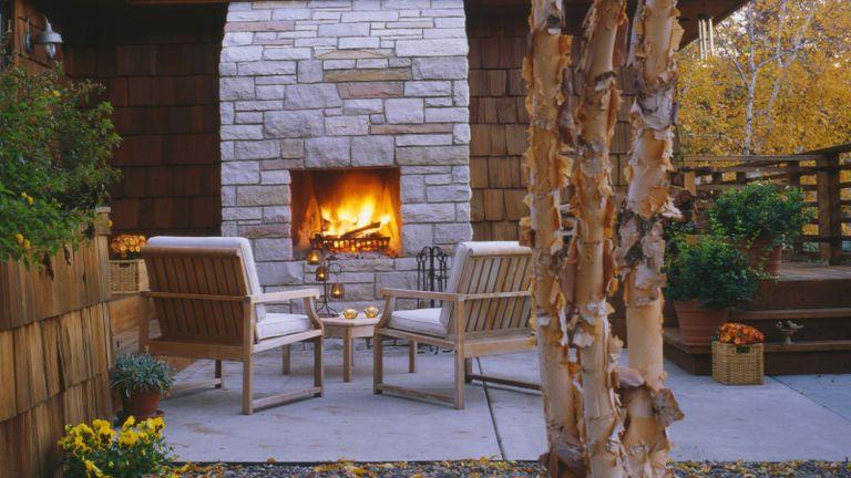 large brick built outdoor fireplace ideas on a backyard patio