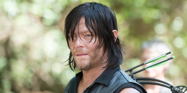 Daryl in the woods with his crossbow