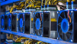 A cryptocurrency mining farm with racks and racks of graphics cards churning away.